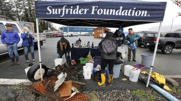 Volunteers unload and sort debris and garbage they found during the Surfrider Pacific Rim Christmas Jingle Cleanup Event along the Tofino harbour shorefront near the 4th Street government dock and marina on December 2, 2016.