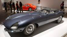 1963 Jaguar E-Type Roadster (front) and a 1946 Cisitalia 202 GT (rear) on display at the grand opening of the Museum of Modern Art (MoMA) in Queens, New York on June 29, 2002. (REUTERS/Chip East)