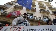 Yyouth activists of Spain's labour union Comisiones Obreras protesting against austerity measures in front of the European Union Parliament office in Barcelona. (ALBERT GEA/REUTERS)