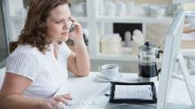 If there is no contract language to the contrary, it is possible that a work-from-home employee could work from home wherever he or she wanted, within reasonable limits. (Jupiterimages/Getty Images)
