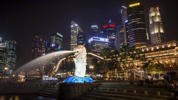 "Singapore's iconic Merlion statue features prominently on the original waterfront of Singapore. The mythical creature, with the head of a lion and the body of a fish, is used widely to promote the island state. The lion head represents Singapore's original name ""Singapura,"" meaning lion city in Sanskrit, while its fish body represents its origins as a fishing village. (Edwin Koo for The Globe and Mail)"