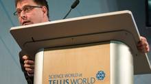 B.C. NDP Leader Adrian Dix leans forward to listen to a question from a reporter during a news conference at Science World in Vancouver on Feb. 11, 2013. (Darryl Dyck/The Canadian Press)