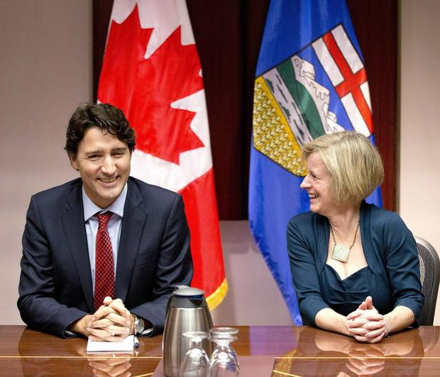 Prime Minister Justin Trudeau, left, and Alerta Premier Rachel Notley chat prior to a roundtable meeting with oil and gas producers in Calgary, Alberta, on Thursday, Feb. 4, 2016.