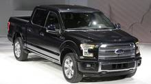 Ford unveils the new F-150 with a body built almost entirely out of aluminum. at the North American International Auto Show in Detroit, Monday, Jan. 13, 2014. (Carlos Osorio/AP Photo)