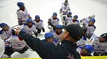Head coach Gary Hunter talks to his players on Vancouver Thunderbirds Atom A2 during their game against Richmond Seafair A2 in Richmond, British Columbia, Canada September 29, 2011. (Jeff Vinnick/The Globe and Mail/Jeff Vinnick/The Globe and Mail)