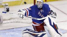New York Rangers goalie Henrik Lundqvist makes a save during the first period of Game 4 of the NHL hockey Stanley Cup playoffs Eastern Conference finals against the Montreal Canadiens, Sunday, May 25, 2014, in New York. (Seth Wenig/AP)