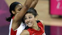 Canada's Natalie Achonwa, front, is pressured by United States' Maya Moore during their women's quarterfinal basketball game at the 2012 Summer Olympics, Tuesday, Aug. 7, 2012, in London. (Lefteris Pitarakis/AP)