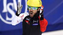 Charles Hamelin reacts after finishing first during the men's 1,500m finals of the ISU World Championships at Maurice Richard Arena. (Jean-Yves Ahern/USA Today Sports)