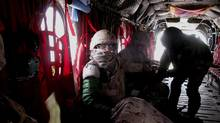 Suzanne Steele, foreground, in a Chinook helicopter, will see her Requiem premiered by the Calgary Philharmonic.