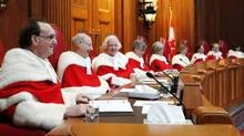 Justice Michael Moldaver, left, and his Supreme Court colleagues, November 14, 2011. (FRED CHARTRAND/THE CANADIAN PRESS)