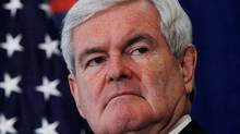 U.S. Republican presidential candidate and former Speaker of the House Newt Gingrich stands during a rally in Jacksonville, Florida Jan. 27, 2012. (Shannon Stapleton/Reuters)
