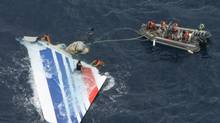 In this Monday, June 8, 2009 file photo released by Brazil's Air Force, Brazil's Navy sailors recover debris from the missing Air France Flight 447 in the Atlantic Ocean. (Anonymous/ASSOCIATED PRESS)