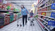 A woman looks for goods at a supermarket in Beijing. (REUTERS/KIM KYUNG-HOON)