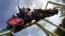 People on a roller coaster (TOBY MELVILLE)