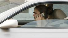 A woman talks on her cellphone while driving in Burbank, Calif. (FRED PROUSER/REUTERS)