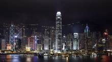 A 2012 night view of the Hong Kong Island's skyline, with its harbor and neon-lit skyscrapers. (Vincent Yu/AP)
