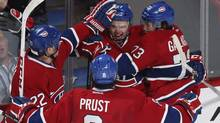 Montreal Canadiens' Alex Galchenyuk (C) celebrates his first NHL goal with teammates Brendan Gallagher (73), Brandon Prust (8) and Tomas Kaberle (22) during second period NHL of their hockey action against the Florida Panthers in Montreal, January 22, 2013. (CHRISTINNE MUSCHI/REUTERS)
