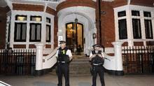 Police officers stand outside Ecuador's London embassy where WikiLeaks founder Julian Assange has sought political asylum, on June 19, 2012. (Paul Hackett/REUTERS)