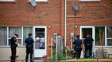 Police officers knocked on all the doors of a townhouse complex at the corner of Morningside Avenue and Danzig Street on Tuesday. (Galit Rodan/The Globe and Mail)