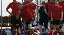 Canada's Christine Sinclair, foreground, trains with her teammates during a women's soccer training session at the 2012 London Summer Olympics, in Coventry, England, Wednesday, Aug. 8, 2012. (Hussein Malla/AP)