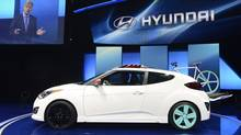 The Hyundai Veloster C3 concept car is unveiled during a news conference at the 2012 Los Angeles Auto Show in Los Angeles, California November 28, 2012. (PHIL McCARTEN/REUTERS)