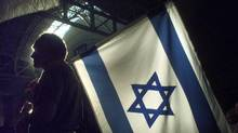 The Israeli flag flies at a Toronto conference centre during celebrations marking the Jewish state's 50th birthday on April 30, 1998. (Fred Lum/Fred Lum/The Globe and Mail)
