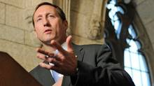 Defence Minister Peter MacKay speaks to reporters on Parliament Hill after a Tory caucus meeting Nov. 16, 2011. (Sean Kilpatrick/Sean Kilpatrick/The Canadian Press)
