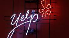 Yelp's logo is seen in neon on a wall at the company's Manhattan offices in New York. (Kathy Willens/AP/Kathy Willens/AP)