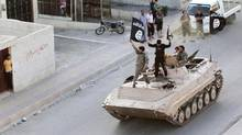 Militant Islamist fighters take part in a military parade along the streets of northern Raqqa province June 30, 2014. (Reuters)