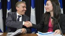 Quebec Finance Minister Nicolas Marceau and Natural Resources Minister Martine Ouellet on Monday, just after presenting a plan to raise mining royalties. (CLEMENT ALLARD/CP)