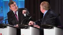 Toronto mayoral candidates John Tory, left, and Rob Ford exchange barbs during Thursday's debate. (Fred Lum/The Globe and Mail)