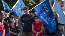 Workers and family members participate in the annual Labour Day parade in Halifax on Monday, Sept. 3, 2012. (Andrew Vaughan/THE CANADIAN PRESS)