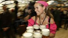 Oktoberfest waitress Babsi carries beer mugs during the first day at Munich's 175th Oktoberfest in Munich September 20, 2008. (© Michaela Rehle / Reuters/Michaela Rehle/Reuters)