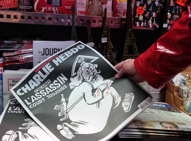 The special commemorative edition of Charlie Hebdo is shown at a Paris newsstand in Paris.