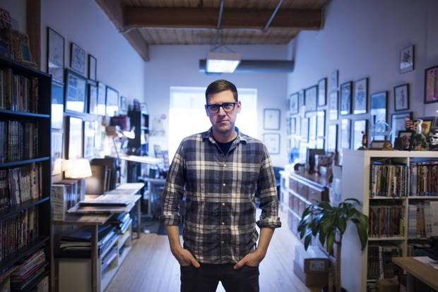 Jeff Lemire, seen in his Toronto studio, says he loves 'bouncing between things,' as evidenced by all the projects he's working on at the moment.