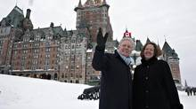 Quebec Premier Jean Charest, left, and Alberta Premier Alison Redford walk by the Chateau Frontenac following a meeting January 11, 2012 in Quebec City. (Jacques Boissinot/THE CANADIAN PRESS)
