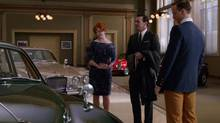 In an episode three weeks ago, Joan Holloway posed as Don Draper's wife as the two took a Jaguar for a test-drive. (none/AMC)