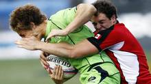 Canada's Tyler Ardron, right, has already won sevens gold at the 2011 Pan American Games. (Isaac Brekken/THE CANADIAN PRESS)