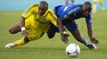 Montreal Impact's Hassoun Camara battles for possession of the ball during first half MLS action in Montreal, Sunday, July 8, 2012. (Paul Chiasson/THE CANADIAN PRESS)