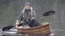 "Alexandra Morton canoes with Ahta the dog in the Ahta River in the rain. Last month Simon Fraser University awarded her an honorary Doctorate of Science, stating her ""work linking sea lice infestation in wild salmon to fish farming in the Broughton Archipelago has drawn international attention and challenged both the salmon farm industry and the government officials who regulate it.""She is walking from her house in Sointula, near Port McNeill on Vancouver Island to Victoria, more than 400 kms away, where, on May 8th, she will hold a rally with whatever supporters she's managed to gather along the way, in an attempt to get the provincial government to pay attention.Ms. Morton wants fish farms in B.C. to move out of the open net sea pens where they now raise millions of salmon, to transition to land-based, contained systems. (Alexandra Morton/ The Globe and Mail)"