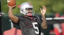 FILE - In this Aug. 9, 2014, file photo, Ohio State quarterback Braxton Miller warms up during an NCAA college football practice, in Columbus, Ohio. Miller, among the top contenders for the Heisman Trophy, reportedly reinjured his throwing shoulder during practice. (Jay LaPrete/AP)