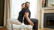 Edna Melculj and Peter Pereira demonstrate the back-to-back squat from their Fit2touch program. (Jennifer Roberts for The Globe and Mail/Jennifer Roberts for The Globe and Mail)