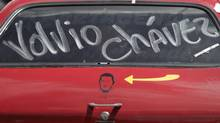 "The words in Spanish ""Chavez is back"" adorn a car window above an image of Chavez on the car door in Caracas, Wednesday, Feb. 20, 2013. President Hugo Chavez's sudden return to Venezuela after more than two months of cancer treatments in Cuba has fanned speculation that the president could be preparing to relinquish power and make way for a successor and a new election. (Ariana Cubillos/AP)"