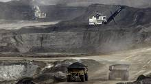 Environmental monitoring of the oil sands has long been a hot potato in the Ottawa-Alberta relationship, with each jurisdiction claiming it was in the best position to undertake the job. (JEFF MCINTOSH/AP)