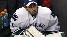 Vancouver Canucks goalie Roberto Luongo (1) sits on the bench in the second period against the Los Angeles Kings during Game 4 of their NHL Western Conference quarter-finals in Los Angeles, California April 18, 2012. (DANNY MOLOSHOK/REUTERS)