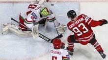 Canada's Ryan Nugent-Hopkins tries to score past Belarus' goalkeeper Dmitri Milchakov and Nikolai Stasenko during their 2012 IIHF men's ice hockey World Championship game in Helsinki. (GRIGORY DUKOR/Reuters)