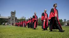 Graduating students head toward Convocation Hall at the University of Toronto on June 15, 2012. (Matthew Sherwood For The Globe and Mail)