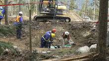 BC SPCA constables and forensic anthropologists exhume bodies at a mass grave of sled dogs near Whistler, B.C., May 8, 2011. (SPCA/SPCA)