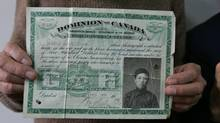 Jack Chung holds the 1914 head-tax certificate of his father, Sik Kan Chung. (Jim Ross/The Globe and Mail)