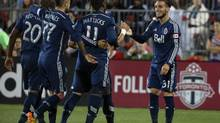 Vancouver Whitecaps forward Darren Mattocks celebrates his goal with forward Russell Teibert and midfielder Pedro Morales and midfielder Nigel Reo-Coker against the Toronto FC (Tom Szczerbowski/USA Today Sports)
